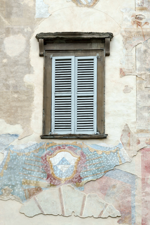 tatty: Old faded mural on a wall in Citta Alta Bergamo Stock Photo