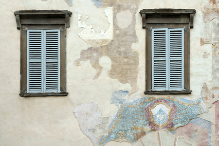 wall mural: Old faded mural on a wall in Citta Alta Bergamo Stock Photo