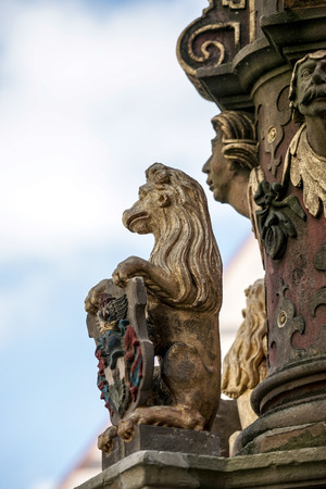 Statue of a lion on St. Georges Fountain in Rothenburg ob der Tauben Stock Photo