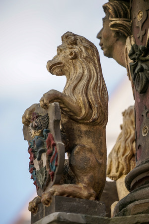 slaying: Statue of a lion on St. Georges Fountain in Rothenburg ob der Tauben Stock Photo