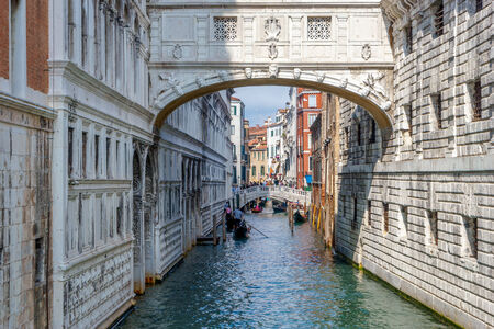 gondoliers: Gondoliers ferrying people in Venice Stock Photo