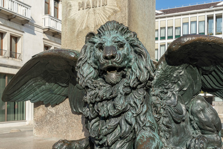 daniele: Winged Lion beneath the statue of Daniele Manin in venice
