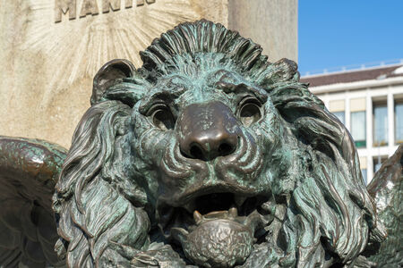 Winged Lion beneath the statue of Daniele Manin in venice