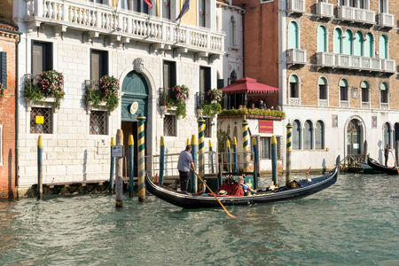 ferrying: Gondolier ferrying a passenger along the Grand Canal