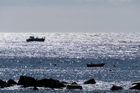sihouette: Boats off San Juan in Tenerife