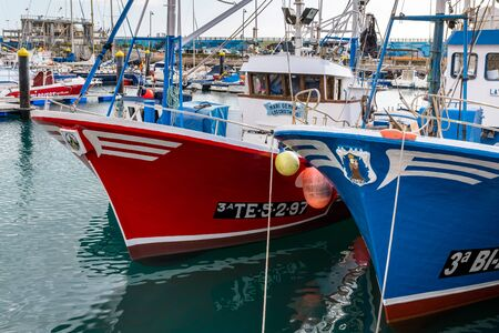 afloat: Fishing boats moored in Los Christianos harbour Tenerife Editorial
