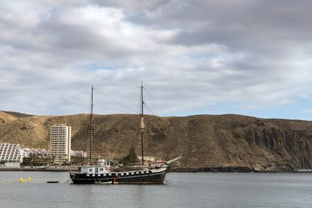 afloat: Yacht moored in Los Christianos harbour Tenerife