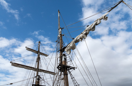 furled: Rigging on an old yacht moored in Los Christianos harbour Tenerife Stock Photo
