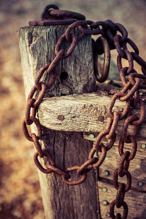 attached: Old rusty chain attached to the bow of a wooden boat at Dungeness