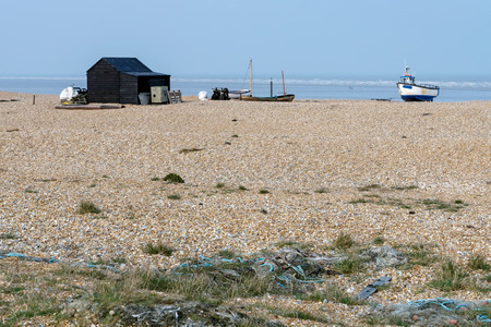 shack: Old shack and boats on Dungeness beach Stock Photo