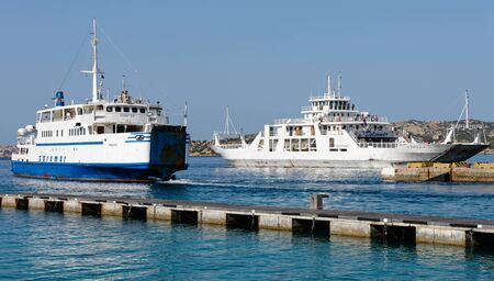 ferries: Car ferries leaving and entering  Palau port Sardinia Editorial