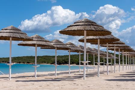 parasols: Parasols at Liscia Ruja beach in Sardinia
