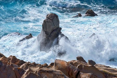 pounding: Waves pounding the coastline at Capo Testa Sardinia