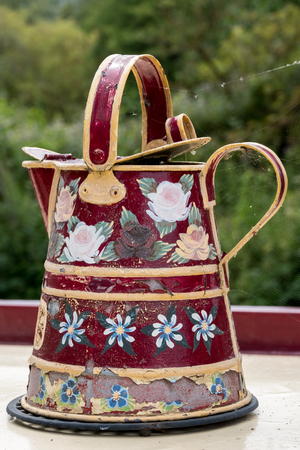 berkshire: Painted Kettle on a narrow boat Kennet and Avon Canal in Aldermaston Berkshire on July 5, 2015