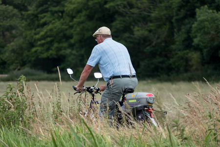 berkshire: Cycling beside the Kennet and Avon Canal near Aldermaston Berkshire on July 5, 2015. Unidentified man Editorial