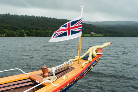 sea snake: Union Jack Flying on the Steam Yacht Gondola on Coniston Water Stock Photo