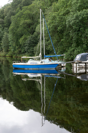 cumbria: Boats moored at Ullswater