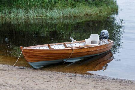 moored: Rowing Boat Moored on Loch Insh