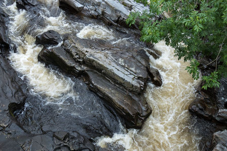 tributary: Rocks at Feshiebridge in Scotland Stock Photo