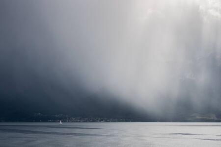 passing over: Storm passing over Lake Geneva in Switzerland