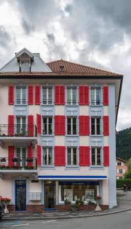 red shutters: Building with red shutters in Vallorbe district Grandes Forges of Switzerland