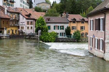 Orbe River flowing through Vallorbe in the district Grandes Forges of Switzerland Editorial