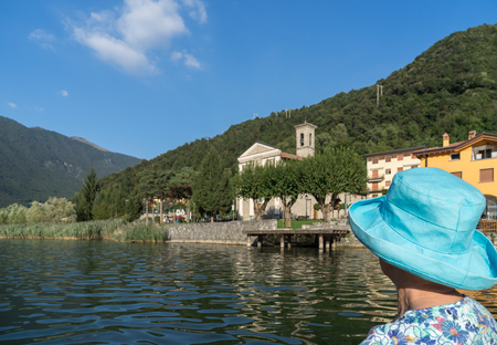felice: Woman looking at the small village of San Felice on the Eastern side of Lake Endine Stock Photo