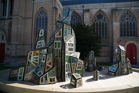 wei: Modern sculpture outside St. Salvators Cathedral in Bruges West Flanders Belgium