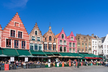 gabled houses: Historic gabled buildings and cafes in Market Square Bruges West Flanders in Belgium
