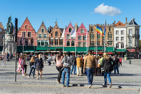 gabled: Historic gabled buildings and cafes in Market Square Bruges West Flanders in Belgium