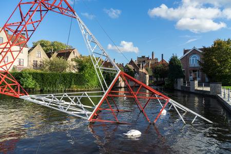 flanders: Pylon in the canal in Bruges West Flanders Belgium