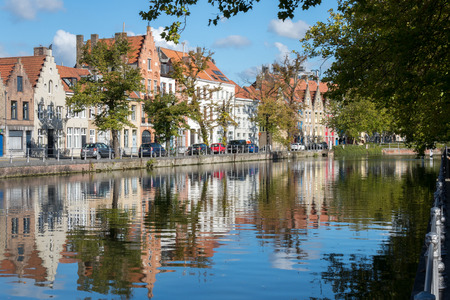 house gables: View along a canal in Bruges West Flanders in Belgium