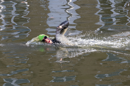 flanders: Person swimming down a canal in Bruges West Flanders in Belgium Editorial
