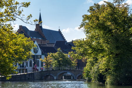 View along a canal in Bruges West Flanders in Belgium
