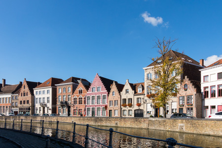 gabled houses: Buildings alongside a canal in Bruges West Flanders in Belgium
