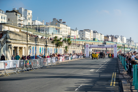 london to brighton: Cars approaching the Finish Line of the London to Brighton Veteran Car Run