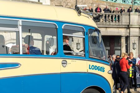 london to brighton: Chris Evans Driving an Old Bus approaching the Finish Line of the London to Brighton Veteran Car Run