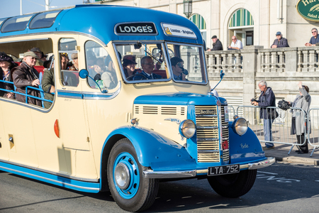 london to brighton: Old Bus approaching the Finish Line of the London to Brighton Veteran Car Run Editorial