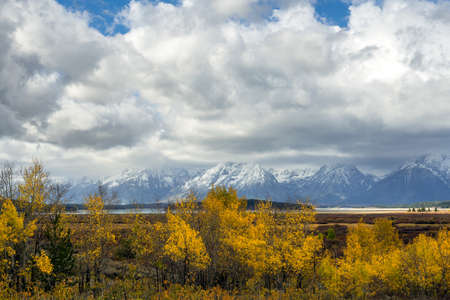 cloud capped: Autumn in the Grand Tetons Stock Photo