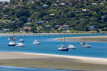 inlet: View of boats in the Tairua Inlet in New Zealand