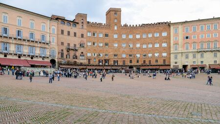 awnings windows: Tourists in Sienna