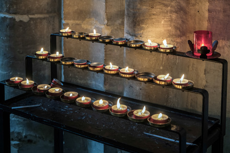alight: Candles in Winchester Cathedral Stock Photo