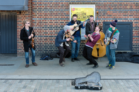 fiddles: Group of Men Busking on the Southbank
