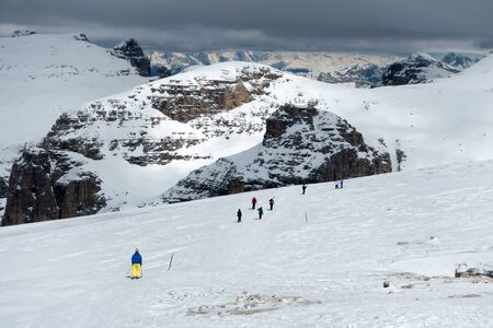People Skiing from Sass Pordoi in the Upper Part of Val di Fassa Stock Photo