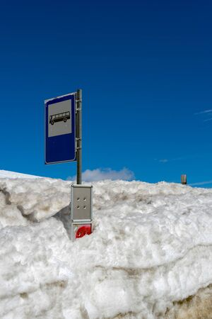 sud tirol: Bus Stop covered in snow at the Pordoi Pass