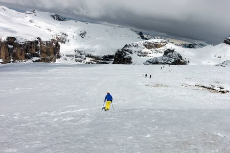 sud tirol: People Skiing from Sass Pordoi in the Upper Part of Val di Fassa Stock Photo