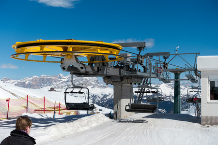 chair on the lift: Chair Lift in the Dolomites at Pordoi