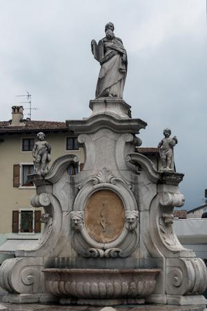 collegiate: Statue outside the Collegiate Church in Arco Trentino Italy