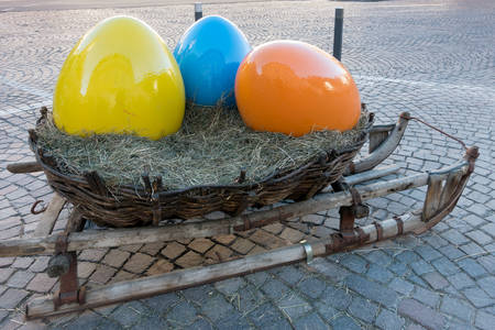giant easter egg: Sleigh with Three Painted Eggs in Ortisei Stock Photo