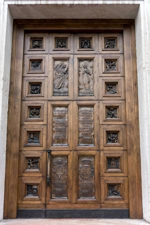 collegiate: Wooden Door of the Collegiate Church in Arco Trentino Italy
